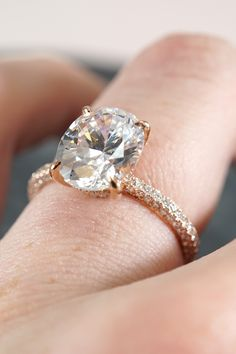 This stunning engagement ring features an oval diamond claw prong set in rose gold with pave set diamond accents on the setting and band. Designed and created by Joseph Jewelry | Seattle, WA | Bellevue, WA | Online | Design Your Own Engagement Ring | #engagementring #diamondring #josephjewelry
