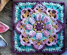 """A Vintage-look, super versatile, decorative floral square with rich texture and enough """"lacy"""" bits to give it a vintage feel. Perfect to use for an afghan, or repeats in a special bespoke baby blanket, a cushion cover, a single or full sized blanket, or a country style throw over any old couch that needs a loving touch! This square ends in a row of single crochets which makes it easy to add more rounds to increase the size."""