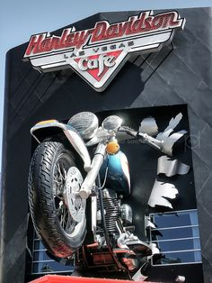 https://flic.kr/p/Q6wf5a | Break Out | Harley Davidson Cafe, Las Vegas, Nevada, USA.  Bursting through the front facade of the Harley-Davidson Cafe is a (7.1:1) scale replica Sportster, a front tire alone weighing 1,200 lbs. and measuring 32 linear feet.  Known to have caused traffic to halt on Las Vegas Boulevard when first erected in September of 1997.  #Architecture #Colour #Photography  www.richardsugden.com  © Richard Sugden 2016 All rights reserved.