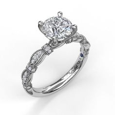 Boasting a classic round cut, this engagement ring makes the most of the details for a truly special design. A scalloped band with diamond-encrusted marquise and buckle shapes add another layer of elegance to this ring. Engagement Ring Types, Popular Engagement Rings, Unique Diamond Engagement Rings, Diamond Cluster Ring, Designer Engagement Rings, Diamond Wedding Rings, Engagement Ring Settings, Diamond Studs, Vintage Engagement Rings