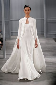 A flowing silk cape complements the breezy silhouette of this Monique Lhuillier design.
