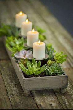 Kynttilä-kukka asetelma.