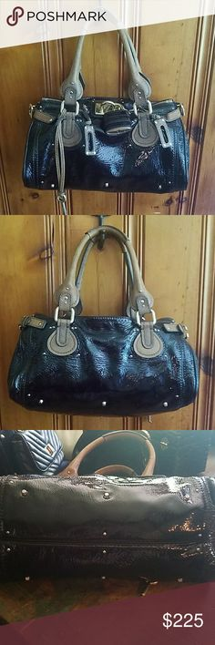 Authentic Iconic Chloe Paddington bag Limited-edition iconic Chloe Paddington bag for your consideration. This is a black patent Paddington in excellent used condition. Dust bag included.  I will consider reasonable offers.  Thank you for shopping my closet. Chloe Bags Satchels