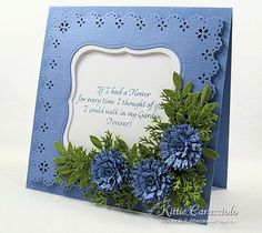 beautiful blue flowers adorn a matted frame...lovely!