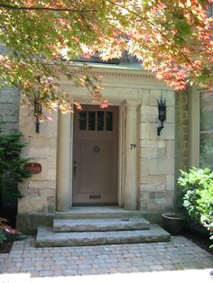 A one of a kind formal entrance to a stone house