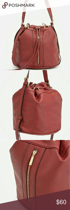 """""""Danny"""" Shoulder Bag Made of faux leather  Size 11L  12H. 11D Gold hardware,  and has 1 interior pocket, 1 interior zip.  Color called Oxblood,  like a kind of a deeper red color. This slso is new, and in packaging detail.  Very nice, and bigger bag. Can hold alot of things. Just Fab Bags Shoulder Bags"""