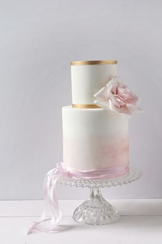 Wildflower Cakes London Watercolour Pink Wedding Cake with sugar rose and gold bands, wrapped in silk ribbon