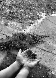 Trying to catch the rain photography black and white rain kids window