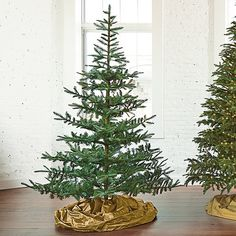 The Fresh Cut Noblis Fir Artificial Christmas Tree features lifelike fresh-looking branches and is so realistic, even you'll forget it's not the real thing.