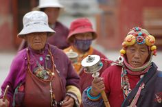 Kham Tibetan Women at Mani Stone Temple in Yushu
