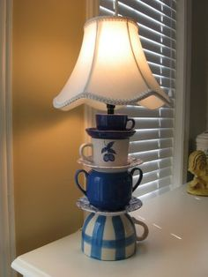 A lamp made out of teacups. Love this for a breakfast nook or kitchen desk.