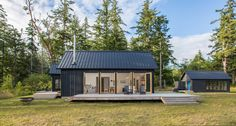 Designed by Prentiss Balance Wickline Architects, this modern cabin offers views of the Olympic Mountains, on the Hood Canal, Washington. Shed Homes, Village Houses, Cob Houses, House And Home Magazine, Modern House Design, Home Fashion, Cabana, Modern Architecture, Sustainable Architecture
