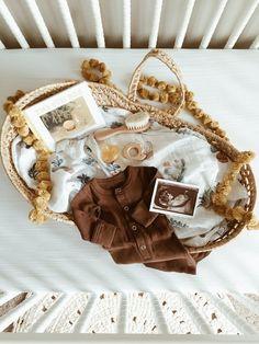 Pregnancy announcement flatlay neutral gender Moses basket.