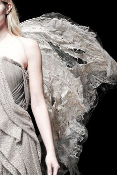 A detail of a decomposing moth wing at Yiqing Yin Haute Couture Spring/Summer 2014