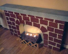 Holiday fireplace make from a cardboard box and a couple of slabs of packing styrofoam. Made this last Christmas and I love it.