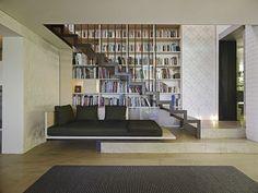 Bookshelves line the taircase wall.