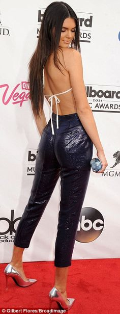 Raiding her sister Kim's Kardashian playbook: Kendall Jenner  showcased her perfectly proportioned posterior in leather trousers