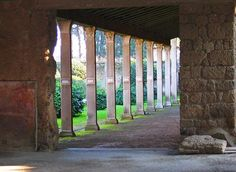 *POMPEII,ITALY~House of Julia Felix-AD79eruption:On the east side of the atrium a door leads to the service area for the bath complex.A long service corridor opens off the SW corner of the atrium while a wide opening in the centre of theS. wall.The garden is framed by elegant stuccoed columns+has a long water feature thought to represent the Canopus canal in Egypt.