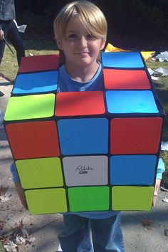 DIY Rubik's cube costume idea.  All you need is a box, some colored paper, and black paint!  Super easy #80s costume idea. http://www.liketotally80s.com/2011/04/80s-costume-rubiks-cube/