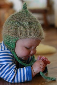 Gorgeous knitted baby hat that has ear flaps and is long in the back to cover the neck!
