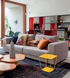 i like the yellow table and colorful bookcase.