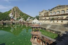A large water tank with pleasure pavilions stands behind Alwar's City Palace Tourist Places, Delhi India, Travel Information, Water Tank, India Travel, Plan Your Trip, Day Trips, Good Day, Taj Mahal