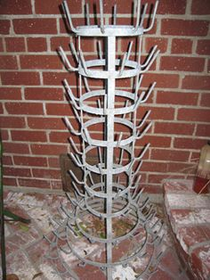 """a french bottle drying rack...egoutoire or """"herrison"""" meaning hedgehog!  Awesome in the garden for a bottle tree or filled with pots planted with succulents."""