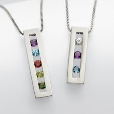 Birthstone necklace that is simple, elegant and will fetch you many compliments.  I  know I have one...actually I am on my 3rd. Started with one similar to the rt 3 stones ...current one has 5 like the left!