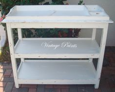 #White and #distressed changing table for a baby's nursery.   All work done by Vintage Paints, in Orlando FL.