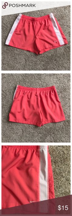 """Nike Size Medium (8-10) Athletic Shorts Excellent condition; Drawstring waist; Across waist - 14"""" (stretches comfortably up to 18""""); Front rise - 10"""", Inseam - 4""""; Polyester Nike Shorts"""