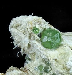 Andradite variety Demantoid Garnets from Malenco Valley, Lombardy, Italy. A beautiful green crystal on Asbestos!