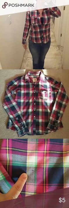 Hollister Pink Plaid Light weight long sleeve button up. Great for layering as we move into Fall. Pre-loved. Has one small hole as shown in 3rd picture. Not noticeable when wearing. Price reflects imperfection. Perfect weekend casual wear! So comfortable! Hollister Tops Button Down Shirts