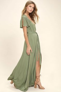 Gaze across the skyline in the City of Stars Sage Green Maxi Dress! Soft woven poly shapes a plunging surplice neckline and fluttering short sleeves. Fitted waist with tying sash tops a wrapping maxi skirt. Sage Green Maxi Dress, Olive Green Bridesmaid Dresses, White Maxi Dresses, Dresses Dresses, Green Dress With Sleeves, Sage Dresses, Green Lace, Club Dresses, Long Dresses
