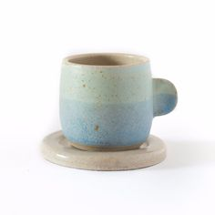 Handmade Espresso Cups: Beautiful handmade ceramic cups by Libby Ballard. Evocative of the sea and coastal landscape these handthrown mugs are all unique. Made from flecked stoneware clay Libby likes to experiment with glazes and textures to achieve the desired effects. Due to the processes involved each piece takes 2 to 3 weeks to be completed.   All products are food safe, microwave and dishwasher proof although it would be better to handwash to ensure longevity of the pieces.  These…