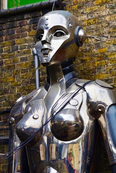 robot girl. Its one of the huge robots standing outside Cyberdog in Camden Market (London). They're about 9ft tall, there's a guy one too.