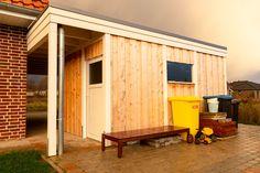 Flachdach Carport aus Holz mit Abstellraum ist eine gute alternative wenn Sie Stauraum benötigen.