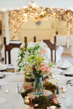 Mason jar floral arrangements for rustic wedding. Exactly what I picture my idea table arrangement/centerpiece.  Would be ecstatic if Geranium Lake Flowers could do something like this for our big day. http://geraniumlake.com/