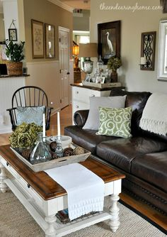 The Endearing Home family room via Savvy Southern Style room feature leather neutral black white coffee tables, southern style, famili room, southern living room, black white, living room leather, live room, coffe tabl, leather couches