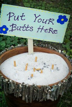 """For those visitors......Outdoor ashtray for the smokers.  So cute...""""Put your butts here""""."""