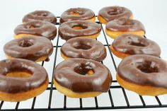 Chocolate Glazed Doughnuts Ingredients 1 cup of milk 1 ounce of fresh yeast 3 cups of flour pound of butter 3 egg yolks 3 tablespoons of granulated sugar Grated peel of 1 lemon 1 package of dar… Fun Desserts, Delicious Desserts, Dessert Recipes, Yummy Food, Frosting Recipes, Drink Recipes, Donut Recipes, Baking Recipes, Chocolate Glazed Donuts Recipe