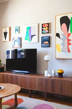 As stone countertops and stainless steel appliances are to a kitchen, a large flat panel television (and a comfy couch) in the living room is to a typical American household. But there's one continuing trend we'd like to see people stop doing: hanging flat-screen televisions over the fireplace.