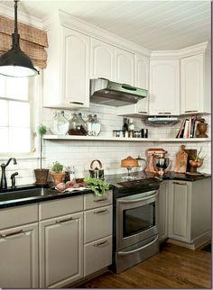 darker lower cabinets plus shelf under top cabinet