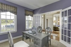 Relaxing study office area with french doors and lavender walls at the Dartmouth II at Sheridan Estates by Dan Ryan Builders. Home Style Ideas