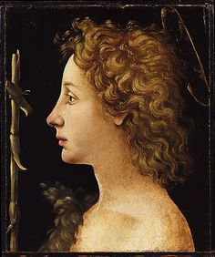 The Young Saint John the Baptist, Piero di Cosimo; includes the saint's attributes of a furry garment and cruciform staff. (Metropolitan Museum of Art)