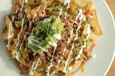 Mad Mexican Loaded Nachos  Mad Mexican Taco House, 405 Jane St Toronto Taco House, Mexican Tacos, Nachos, Toronto, Mad, Ethnic Recipes, Tortilla Chips