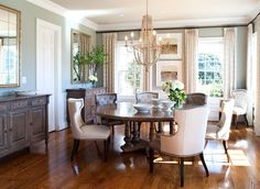 Kristin Peake Interiors, LLC.- love the floor color and light colored chairs with dark table.