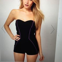 Black romper Black romper with purple detailing. This romper is fitted and great for all heights. Hidden zipper in the back. The purple detailing gives the illusion of an hourglass figure. Worn once, in perfect condition. SOLD OUT in stores ASOS Pants Jumpsuits & Rompers