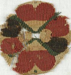 MEDIUM Flax, wool DATES 5th-7th century C.E. DIMENSIONS 3 x 3 1/4 in. (7.6 x 8.3 cm)
