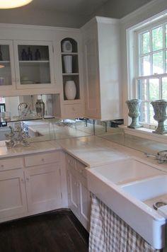 Original cabinets [1940's].....painted...new knobs. Then the mirrored backsplash...yep. new granite countertops and sink.