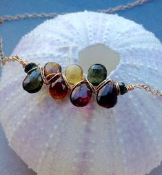 7 Watermelon Tourmaline puffy briolettes dangle from a sterling silver or gold filled necklace. A special necklace for special occasions such as birthday and anniversary These excellent quality, 100% natural gemstone wire together with two round tourmaline beads. The gemstones